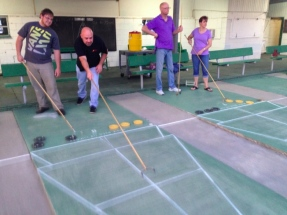Harry and Paul from Buster's Bistro play shuffleboard for the first time