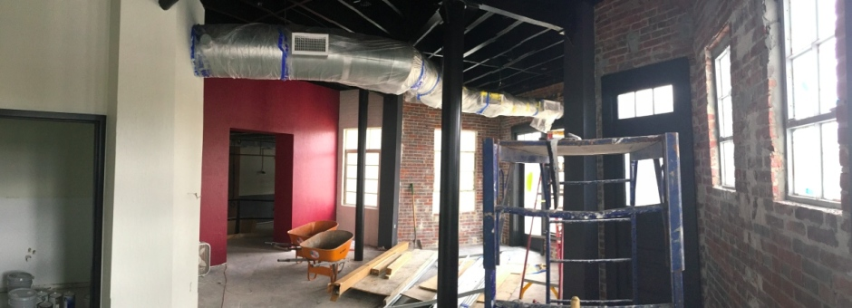 Looking east from the counter area of the barbecue restaurant. At the back left (red wall) is the entrance into 118 S. Park Ave.