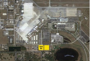 "The proposed Hampton Inn hotel (yellow box marked ""Hotel Site) is slated to locate on about 3 acres of airport property west of Lake Golden. The unmarked yellow box is another 3-acre site (approximately) the airport wants to develope, possibly for a second hotel."